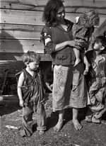 May be a black-and-white image of 2 people, child, people standing and outdoors